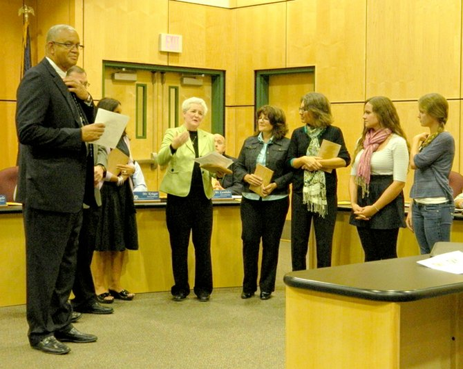 At the Oct. 4 school board meeting, Lenard Morris, Red Cross Blood Donor Service Director, left, and Superintendent Phil D'Angelo, second from left, handed out awards for recognition of excellence for supporting Red Cross blood drives in the Skaneateles high school. Recipients were, from right, High school students and Interact Club members Kelly Valente and Mercedes Morales, District Information Officer Lori Ruhlman, High School Nurse Sherry Nichols, Interact Club Adviser Karen Price and High School Principal Georgette Hoskins.