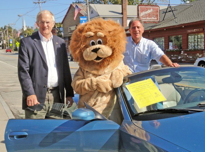 Schroon Lake Lions Club President David Harder greets the new club mascot who was escorted to town by Lion Roger Friedman. The lion will attend the Town of Schroon Lions Club annual prime rib dinner Saturday, Oct. 22, at Witherbee's Carriage House Restaurant.
