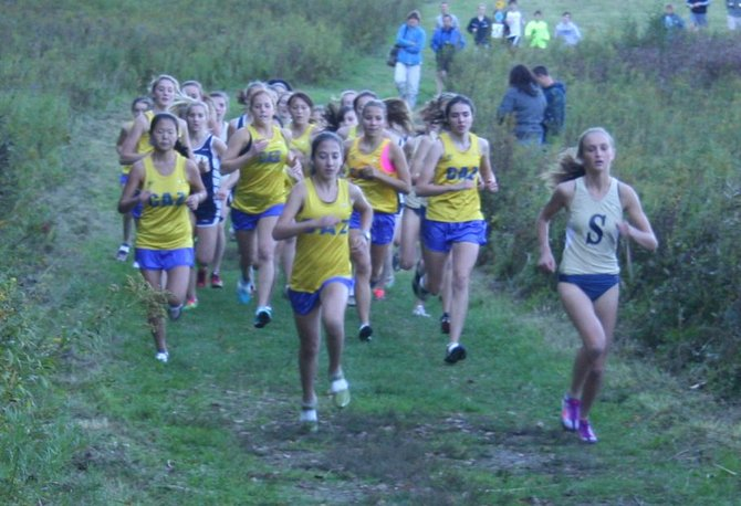 Maddy Adams, right, of Skaneateles, won the race on Oct. 5, but the Cazenovia Lakers, led by Jeanette Cudney, center, dominated the field to beat Homer and Skaneateles in the team scoring. The 4-0 Lakers are tied for the OHSL Liberty division lead and currently ranked fifth in the state, in Class C.