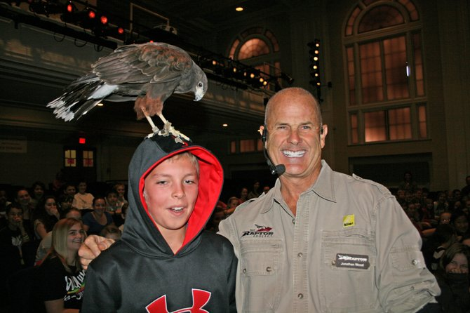 Bethlehem Central Middle School student Brian Harder poses with Raptor Project founder Jonathan Wood. Ryan made a new friend at one of three wildlife education presentations Wood made in the BCMS auditorium on Tuesday, Oct. 11. The Raptor Project is a touring wildlife education program that features 15 to 20 birds, many of home have been rescued after being injured.