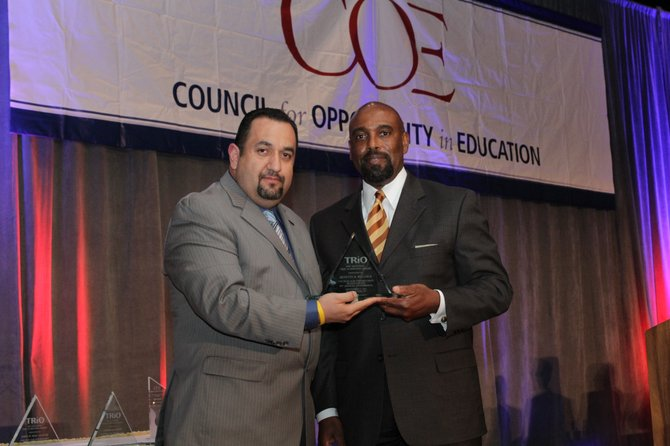Quintin Bullock, president of SCCC (right), with Rafael Topete, a consultant with EDvolution, Inc. and chair of the TRIO Achievers and Alumni Committee, pose on Sept. 27 after Bullock received a TRIO award.