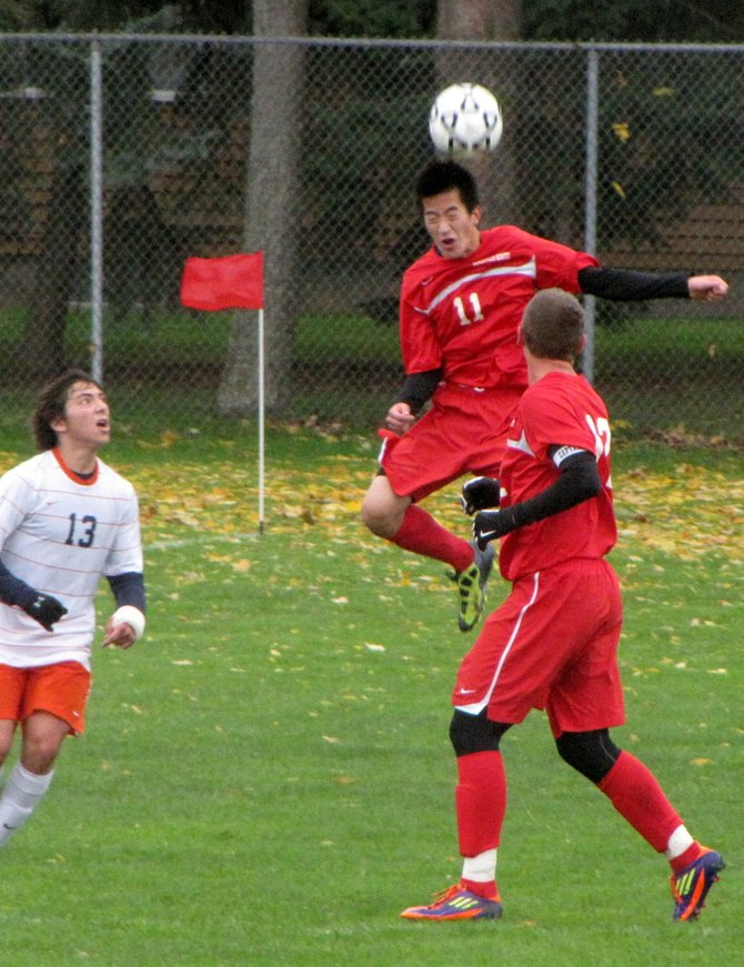 Jamesville-DeWitt midfielder Andrew Lee (11) gets maximum hang time on a header during last Saturday's game against Liverpool.