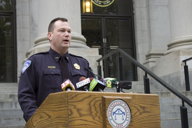 Schenectady County SPCA Chief Mathew Tully discusses details of a settlement reached with the county on Monday, Oct. 17, outside the Schenectady County Courthouse.