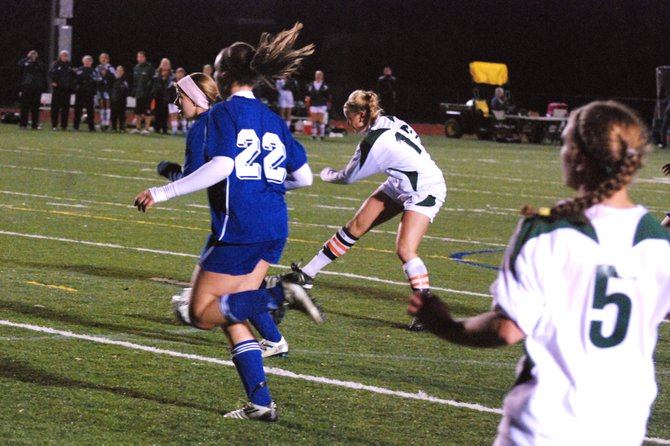 Marcellus senior captain Kathryn Busa (17) launches the game-winning shot in the final minute of the second overtime of last Monday night's game against Westhill, where the Mustangs prevailed 2-1.
