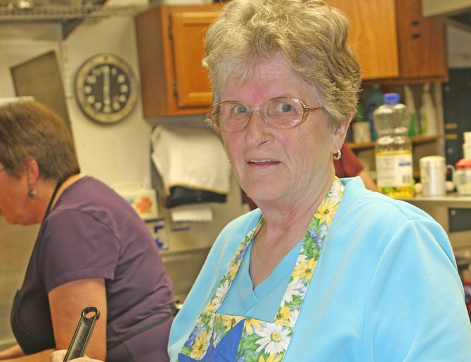 Margaret Beuerlein, director of the Ticonderoga Food Pantry, helps with the cooking during a pancake supper hosted by the Ti Elks. The supper raised money for the pantry.