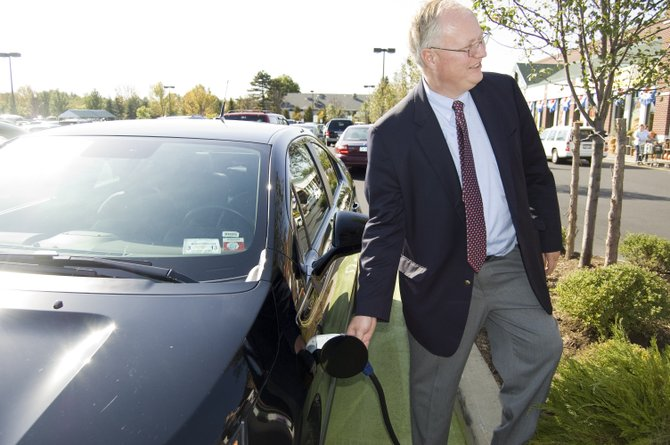 Chris Gardner, attorney for Schenectady County and a Niskayuna resident, plugs in his electric car at the charging stations installed at ShopRite in Niskayuna. The charging stations are free to use.