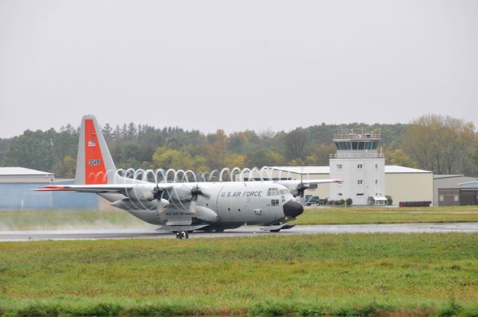 The first LC-130 takes off from Stratton Air National Guard Base around 10 a.m. on Friday, Oct. 14. The overcast morning had rain whipping off the propellers.