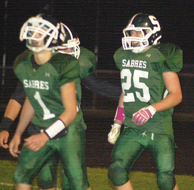 Schalmont's Alex Hildebrans (25) celebrates one of his four touchdowns in the Sabres' 26-14 victory over Schuylerville Oct. 15 that clinched the team's fourth consecutive Section II Class B West Division title.