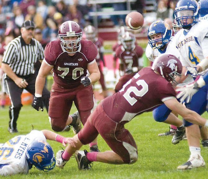 Nicholas Fragale (70) sees the loose ball created when Sean Simpson (52) knocks it out of the hands of Queensbury quarterback Michael Hewitt's hands during last Saturday's Burnt Hills-Ballston Lake home game.