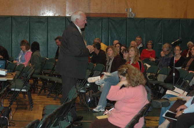 Alan Pole talks with the more than 100 people who attended a discussion on the future of local school districts in the Elizabethtown-Lewis Central School auditorium Oct. 19.