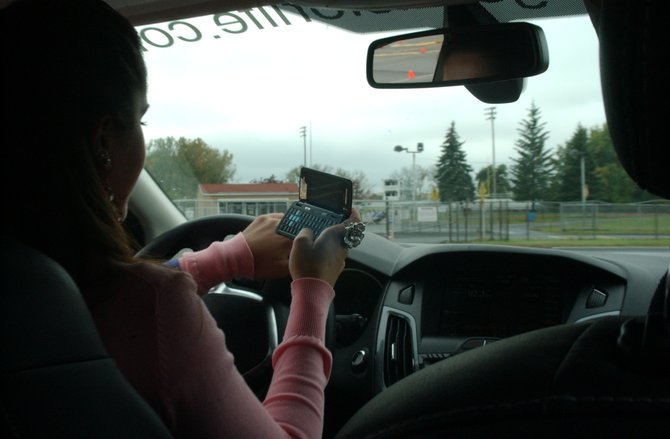 Julia Halburion, a junior at Colonie Central High School, learns how hard it is to drive while sending a text message on her phone. This was part of Ford's Driving Skills For Life Program at Colonie Central High School on Thursday, Oct. 13.