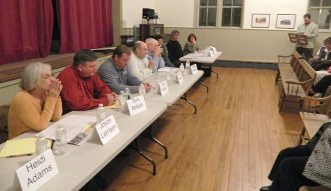 Eight Spafford town election candidates prepare to begin a public candidate forum in Borodino Hall on Tuesday, Oct. 18. The event lasted 90 minutes and covered issues such as hydrofracking, windmills taxes, zoning and codes enforcement.