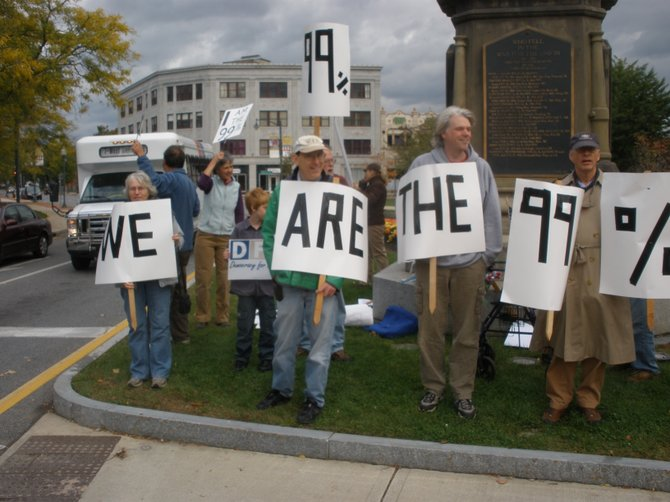 Members of the local Democracy for America chapter protest the unequal distribution of wealth in the U.S. during a protest rally they held Saturday Oct. 15 at the Civil War Soldiers Monument in Glens Falls. A similar rally is to be held from 11 a.m. to noon Saturday Oct 22 at the same site, with members of a group called 'Occupy Glens Falls' joining in.