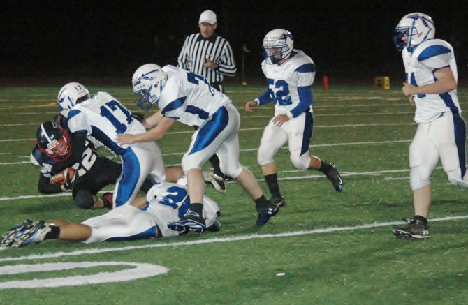 Evan Cobb of AVCS is tackled by a host of Peru defenders.