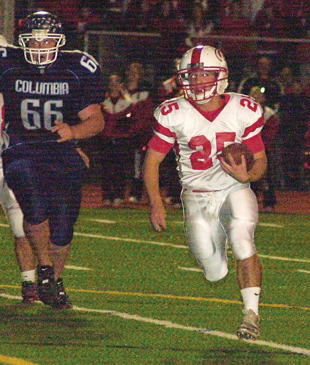 Guilderland's Stephen Polsinelli runs wide during last Friday's Section II Class AA quarterfinal game against Columbia in East Greenbush.