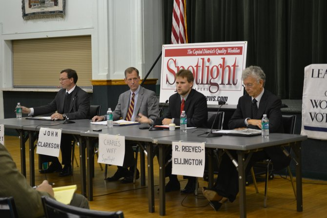 Candidates for Supervisor in the Town of Bethlehem listen to instructions from Spotlight's Charles Wiff during an Oct. 24 debate sponsored by Spotlight and the League of Women Voters of Albany County.  Pictured from left to right: Kyle Kotary, John Clarkson, Wiff, and Richard Reeves-Ellington.