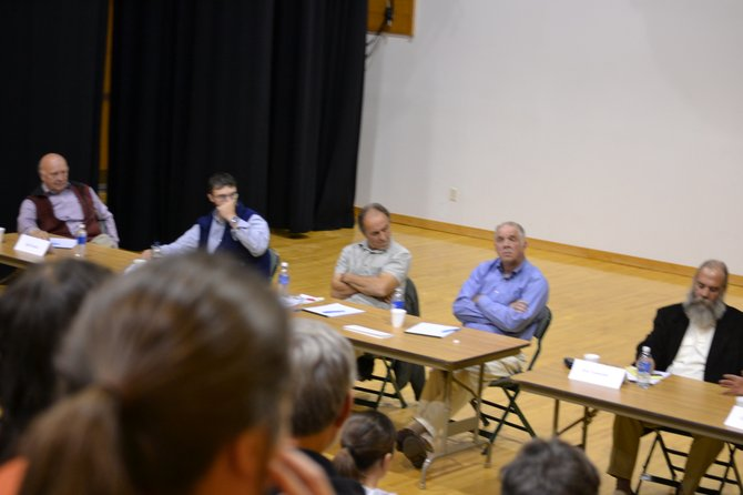 Johnsburg town candidates took turns at platform speeches and answering audience questions at Tannery Pond Oct. 25.