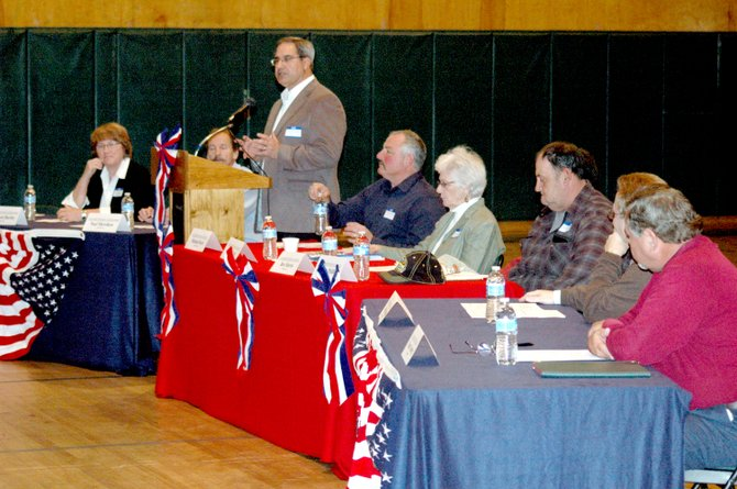 Denton Publications Publisher Dan Alexander, standing, moderates the Meet the Candidates Forum at the Elizabethtown-Lewis Central School with Essex County clerk, Elizabethtown supervisor and Elizabethtown town council candidates. Pictured, from left, are supervisor candidates Margaret Bartley and Noel Merrihew III; town council candidates Michael Doyle, Evelyn Hatch, Ben Morris (obstructed) and James Phillips; and county clerk candidates Joe Provoncha and Brent Vosburg.
