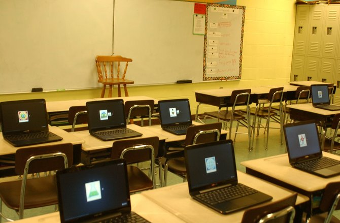 Google Chromebooks sit on each desk in a classroom at St. Thomas the Apostle School in Delmar. The school paid for the computers for each sixth-grade student through a 2010 capital campaign.