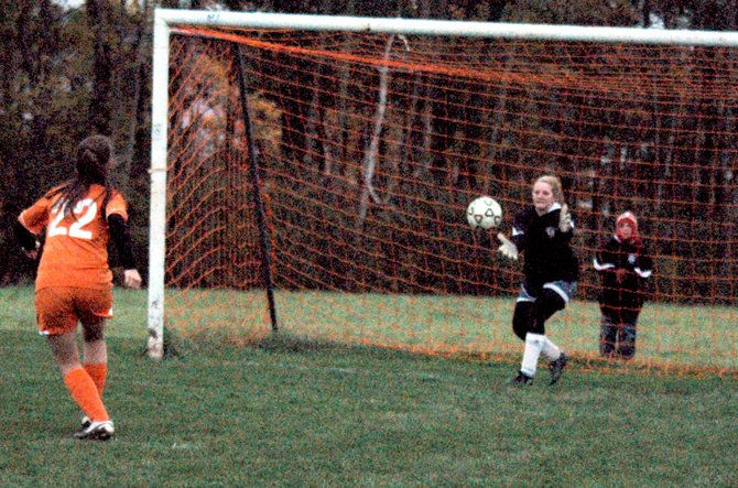 Westport's Karlee McGee saves a penalty kick attempt by Keene's Brittany Guerin.