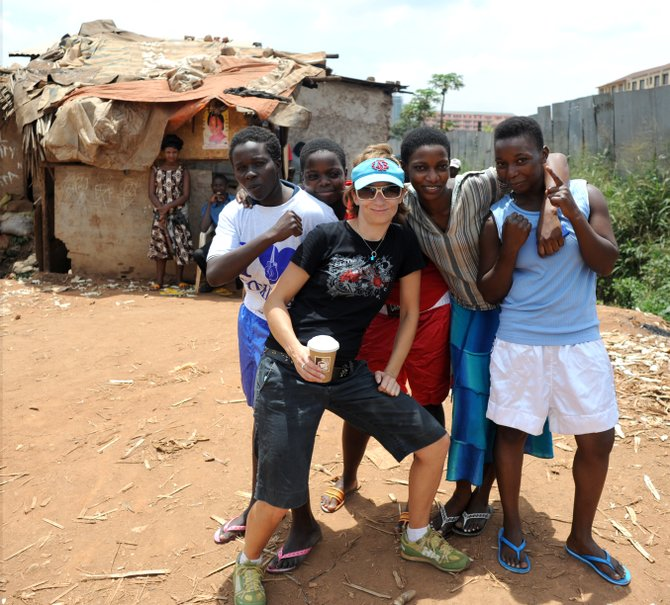 Nicole Dreon skied the slopes of Gore as a youth growing up North Creek. She's now a sports journalist who's searched Africa for the stories of women athletes. Here, she poses with female boxers.