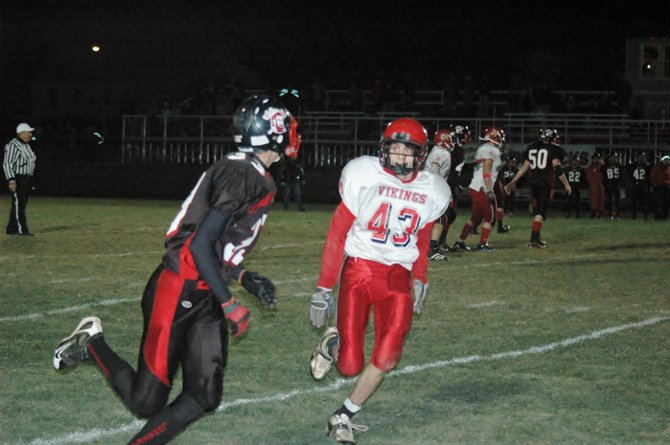 Moriah's Jessup Calkins recorded two interceptions and scored on a 67-yard kickoff return as the Vikings returned to the Class D championship game with a 28-20 win over the Tupper Lake Lumberjacks Oct. 28.