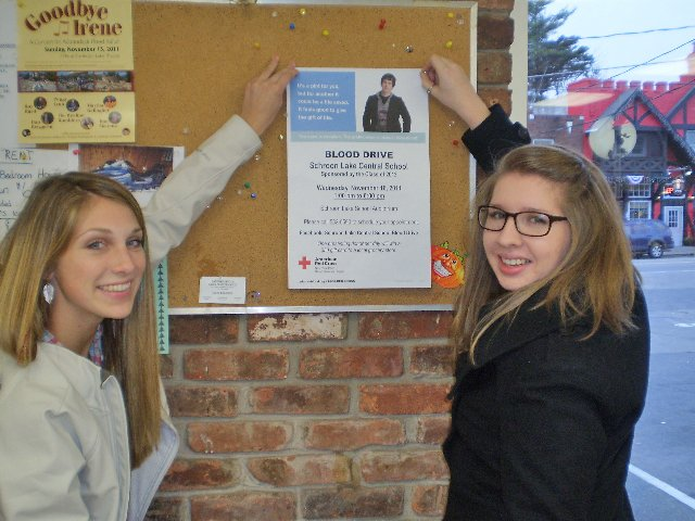 Katelyn Rose and Sarah Desrosier post flyers adcvertisering a blood drive at Schroon Lake Central School. The school's senior class will host an American Red Cross blood drive Wednesday, Nov. 16, 1 to 6 p.m. in the school auditorium.
