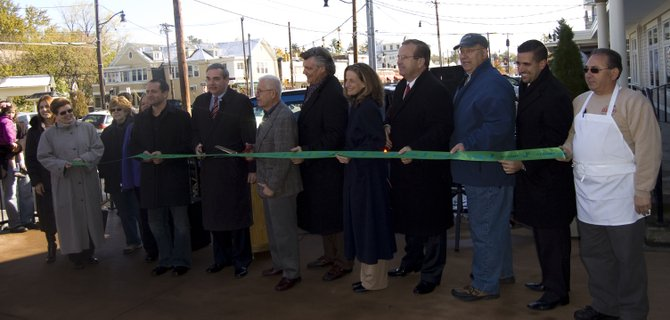 Business owners and officials gathered for a ribbon cutting to celebrate the completion of the streetscape project on Upper Union Street in Schenectady.