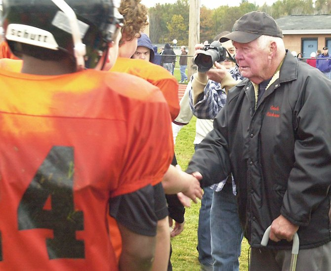Doug Erickson shakes hands with his players following his final game coaching the Mohonasen modified football team last Saturday in Rotterdam.