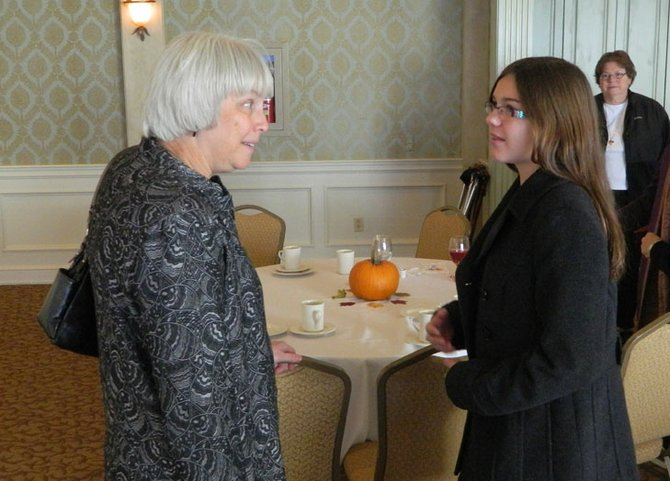 Skaneateles eighth grader Emily Norris, right, talks with Dr. Julie Shimer, CEO of Welch Allyn, about women in STEM careers after Shimer's talk at the AAUW meeting on Oct. 28.