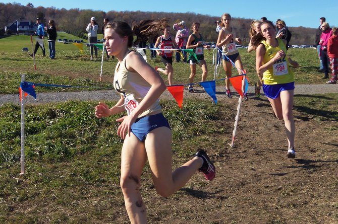 Skaneateles girls cross country sophomore Virginia Hamlin powerfully turns around a switchback at last Saturday's Section III Class C championship at Jamesville Beach. Just behind is freshman Jennifer DeRosa. The young Lakers--three sophomores, a frosh and an eighth-grader--placed fourth.