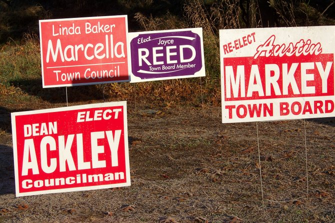 Campaign signs for Warrensburg Town Board candidates compete for motorists' attention Monday at the southern entrance to town.