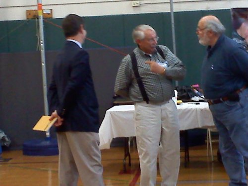Left; Republican Councilman Dan Dustin chats with residents at Forts Ferry Elementary School