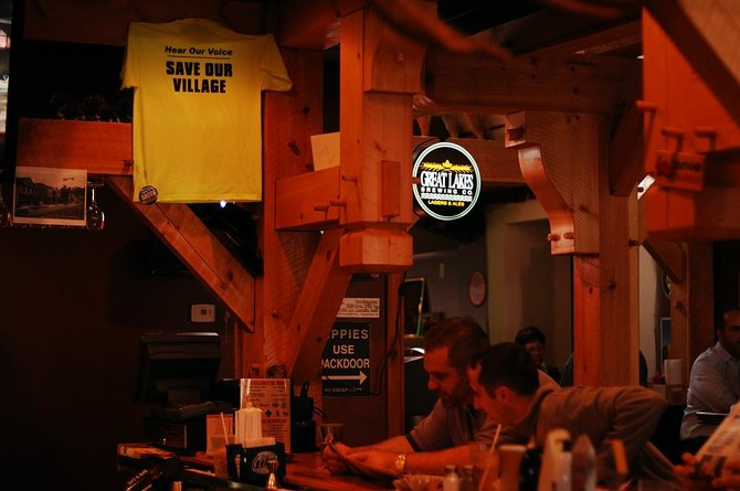"""A """"save our village"""" T-Shirt is hung at Krabby Kirks Saloon, a village of Camillus establishment."""