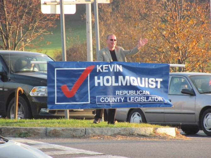 District 10 County Legislator Kevin Holmquist campaigns at Lyndon Corners in DeWitt this afternoon. Holmquist was re-elected legislator over challenger Gwyn Mannion by a vote of 3,041 to 2,495.