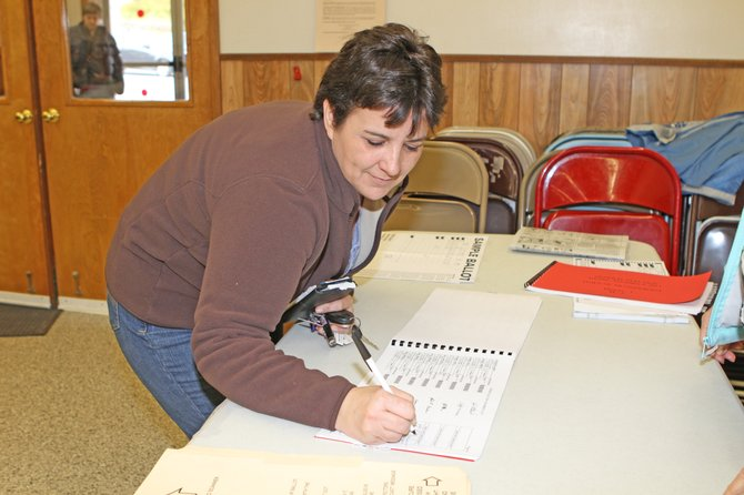 Julie Hunsdon prepares to cast her vote in Ticonderoga on Election Day. There was no suspense Election Day in Ticonderoga, where all the candidates ran unopposed.