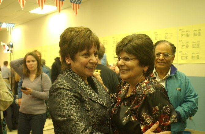 Colonie Supervisor Paula Mahan hugs her sister Donna Barry after declaring victory in the race for the supervisor's seat on Tuesday, Nov. 8. The race has not yet ended as there are still several absentee ballots yet to be counted.