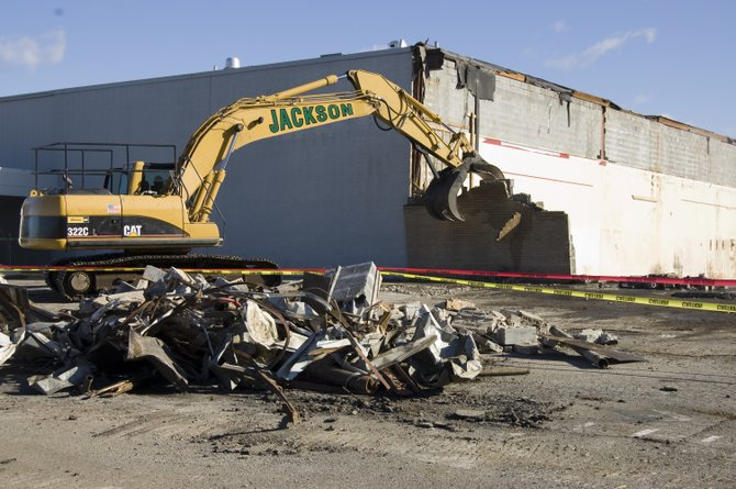 A wall comes crashing down during demolition of the former Kmart building in Glenville on Friday, Nov. 4. Target is planning a grand opening for its new store next October.