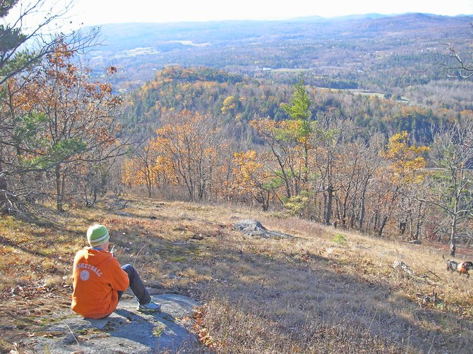 Colvin Chapman of Ticonderoga takes a break from clearing trail to enjoy the view from Cheney Mountain.