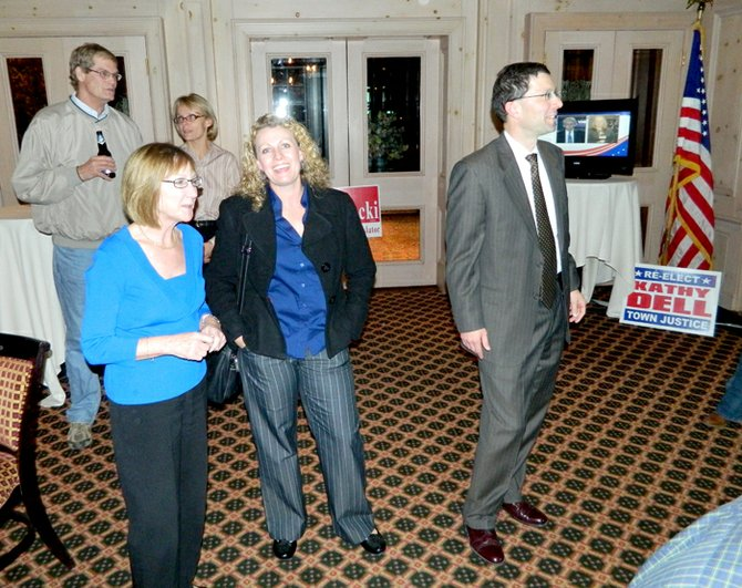 Skaneateles Town Justice Kathy Dell, front left, shortly after learning of her reelection victory on Nov. 8. Behind her are Town Councilor Jim Greenfield and Supervisor Terri Roney, both of whom ran unopposed for reelection to their respective positions. At right is Skaneateles Town Republican Party Chair Riccardo T. Galbato looking at election returns as they were posted to a projected screen in the room in the Sherwood Inn where Republicans gathered on election night.