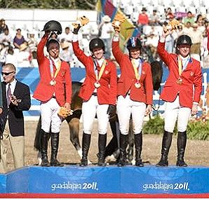 Team USA riders Kent Farrington, left, Christine McCrea, Beezie Madden and McLain Ward wave to their fans in Guadalajara, Mexico after receiving the gold medal in the 2011 Pan American Games.