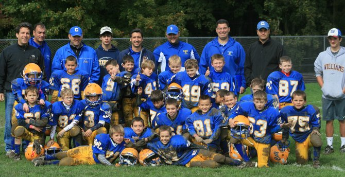 The Cazenovia Laker Mitey Mites pose for a team photo after a great (and muddy) home game. In the front row, sit Vito Borio, left, Michael Parella and Chris Sparks. In the second row, are Emerson Leone, left, Dalton Sevier, Ryan Romagnoli, Jake Germain, Jack Lavelle, Peter McCole, Anthony Pitts, Kaylab Brown, Brice Hodges, and Dylan Lyrek. Behind them, are Anthony Porter, left, Shaun Goodman, Ty Fryer, Guy Germain, Connor Wilson, Rilley Hansen, Evan Murray, Austin Sanders, Jack McDonald and Aidan Coffey. Members of the coaching staff, Joe Borio, left, Mike Parella, Jim Sparks, Ryan O'Herien, Head Coach Bob Romagnoli, Mike Corso, Tom Goodman, Todd Wilson and  Alex Devine proudly stand behind the mites. Not pictured: Coach Neal Coffey.
