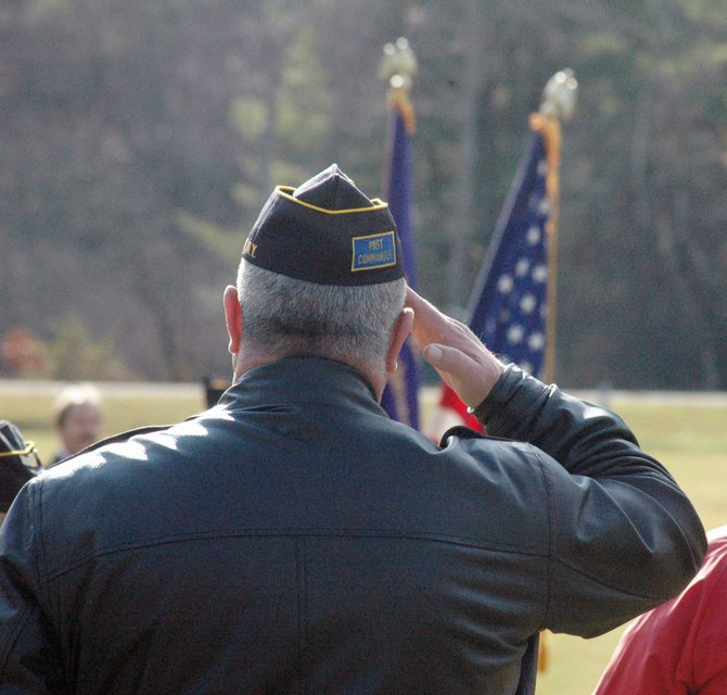 Essex County Sheriff Richard Cutting salutes the flag during the Veterans Day ceremony in Wadhams.