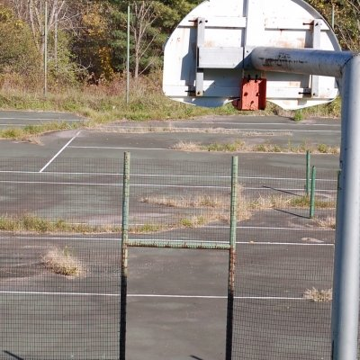 Overlooking the tennis court from the outdoor basketball court at Westport Central School.