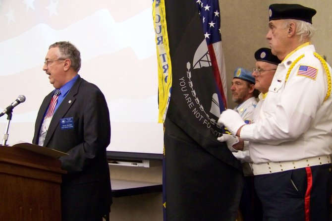 At a Veterans Day ceremony at SUNY Adirondack Friday Nov. 11, Harry Candee of the state Veterans Affairs office talks about how many soldiers who have served our nation are now facing adjustment problems and various hardships, and citizens need to respond to their needs according to their various capabilities.