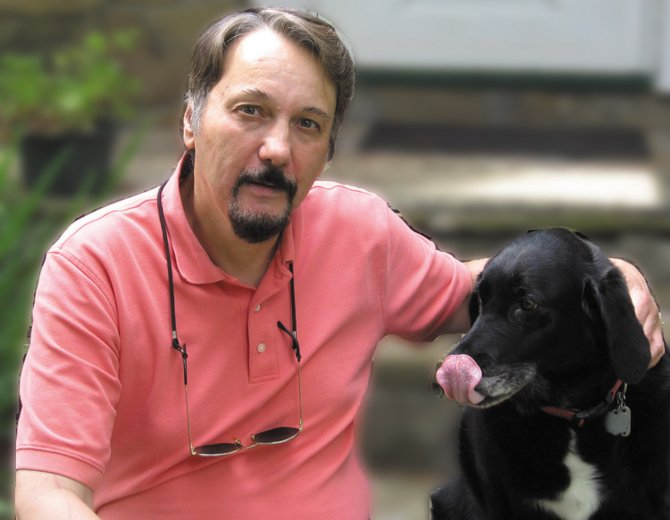 """Local author Craig Stevens posing with his dog, Gretchen, which was an inspiration for the dog in his recently released book """"Legacies of Cherry Ridge."""""""