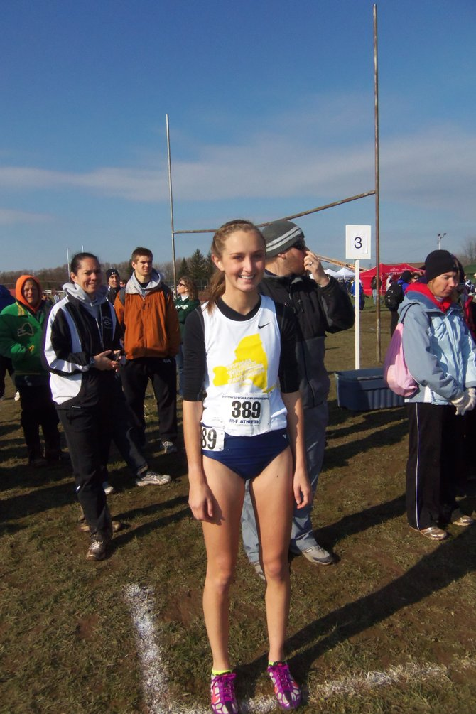 Skaneateles girls cross country runner Madeline Adams stands proudly on the starting line right before the start of last saturday's state Class C cross country championship race at Vernon-Verona-Sherrill. It was the second consecutive state meet appearance for the sophomore, who battled through muddy conditions to take 46th place in a time of 22:39.1.