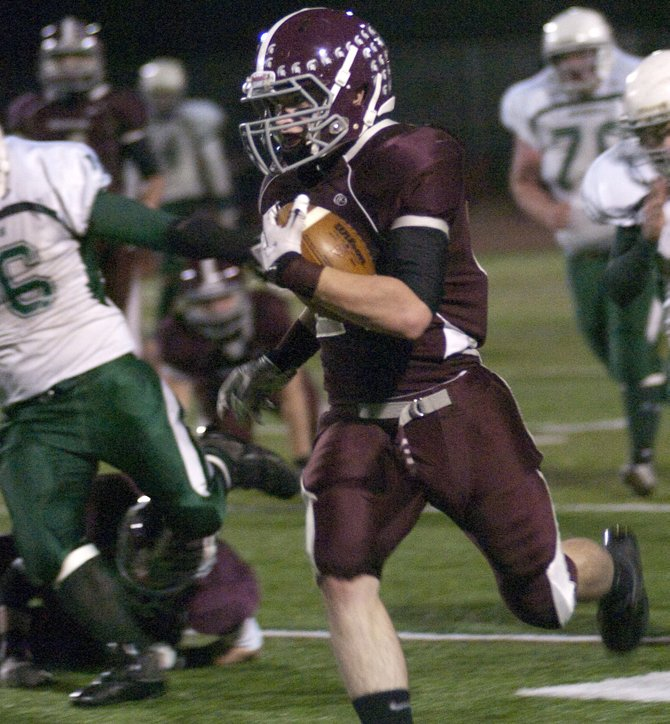 Burnt Hills-Ballston Lake running back Thomas Ruppel finds an opening during the Class A regional game against Franklin Academy Nov. 12 at Shenendehowa High School.