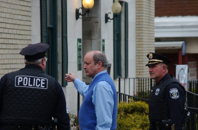 Bethlehem Police Chief Louis Corsi, center, and Deputy Chief Timothy Beebe, right, at TD Bank on Delaware Avenue in Delmar, minutes after it was reportedly robbed.