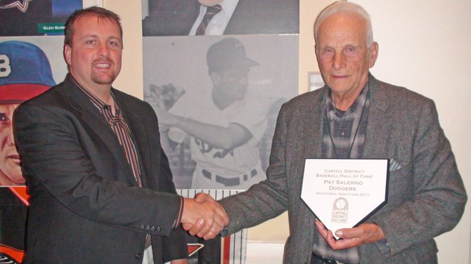 Pat Salerno, right, of Port Henry was part of the inaugural class of the newly-formed Capital District Baseball Hall of Fame. Congratulating him is his son, Tim. Salerno was inducted along with Witherbee native Johnny Podres.